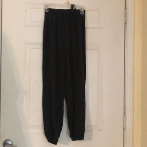 Black parachute type pants with ties.